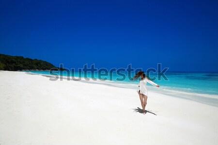 Beautiful sexy bikini model woman posing relaxing on exotic trop Stock photo © Victoria_Andreas