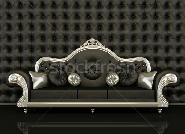 Classic leather sofa with a silver frame on black background Stock photo © Victoria_Andreas