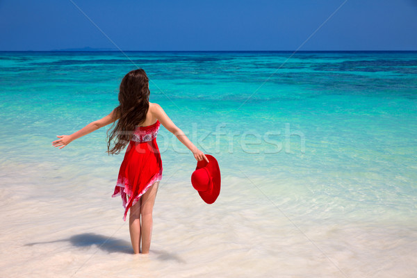 Happy woman enjoying on exotic beach in summer by tropical blue  Stock photo © Victoria_Andreas
