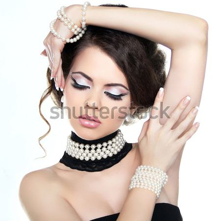 Beautiful Brunette Girl with hairstyle and make up isolated on w Stock photo © Victoria_Andreas