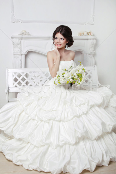 Beautiful attractive bride in wedding luxurious dress with volum Stock photo © Victoria_Andreas