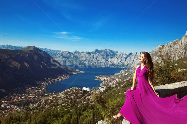 Kotor bay. Montenegro. Romantic Woman in blowing dress above Lan Stock photo © Victoria_Andreas