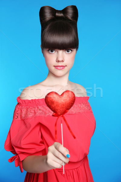 Smiling teen girl with bow hair style, brunette young model hold Stock photo © Victoria_Andreas