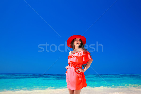 Beautiful elegant woman in red hat enjoying on exotic sea, tropi Stock photo © Victoria_Andreas