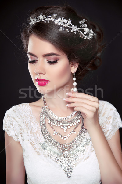 Beauty makeup. Elegant hairstyle. Brunette girl model. Fashion e Stock photo © Victoria_Andreas