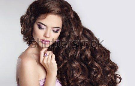 Healthy hair. Manicure. Beautiful brunette young woman with long Stock photo © Victoria_Andreas