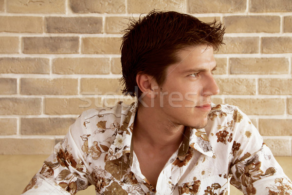 Elegant young handsome man looking at something interesting - Co Stock photo © Victoria_Andreas