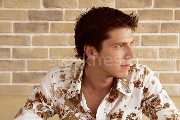 элегантный молодые красивый мужчина глядя что-то интересный Сток-фото © Victoria_Andreas
