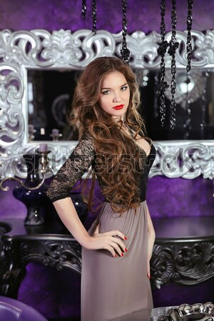 Piękna brunetka dziewczyna model krótki czarna sukienka Zdjęcia stock © Victoria_Andreas
