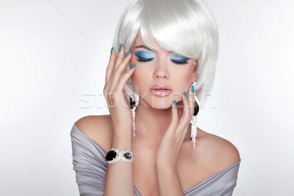 Beautiful fashion blond girl with bob hair. Makeup. Jewelry. Sho Stock photo © Victoria_Andreas