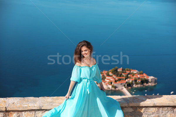 Beautiful brunette Girl in blowing dress. Happy Smiling Young Wo Stock photo © Victoria_Andreas