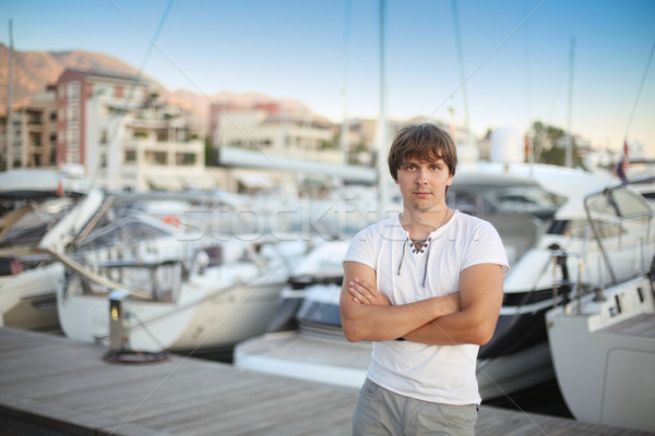 Bel homme luxe yacht plage coucher du soleil extérieur Photo stock © Victoria_Andreas