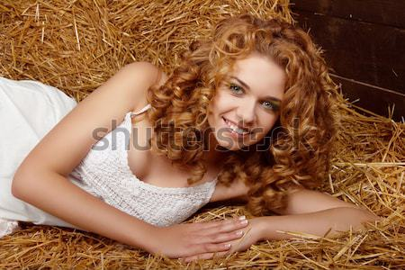 Happy smiling woman on beach with long blond hair Stock photo © Victoria_Andreas