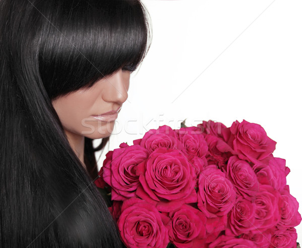 Brunette woman with fringe holding pink bouquet of roses isolate Stock photo © Victoria_Andreas