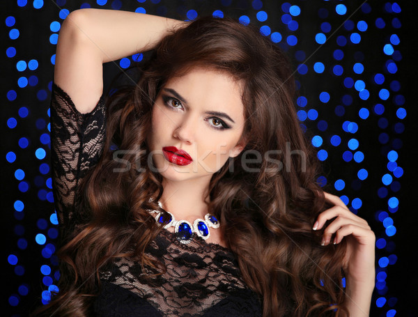 Makeup. Beautiful brunette woman portrait. Fashion jewelry. Sexy Stock photo © Victoria_Andreas