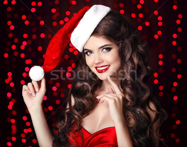 Vonzó boldog mosolyog lány mikulás kalap Stock fotó © Victoria_Andreas