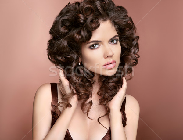 Hairstyle. Beautiful woman with makeup and healthy curly hair st Stock photo © Victoria_Andreas