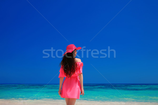 Brunette Woman enjoyng On Tropical Beach. Attractive girl in red Stock photo © Victoria_Andreas