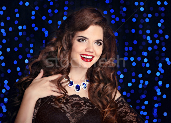 Stock photo: Beautiful laughing brunette. Happy smiling girl with long shiny