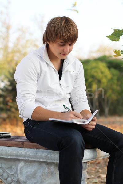 Junger Mann schreiben Poesie Herbst Freien Lächeln Stock foto © Victoria_Andreas