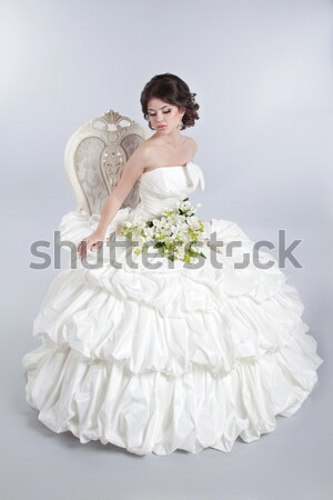 Beautiful charming bride in a luxurious dress. Happy brunette gi Stock photo © Victoria_Andreas