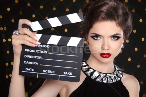 Beautiful brunette woman model holding film clap board cinema. F Stock photo © Victoria_Andreas
