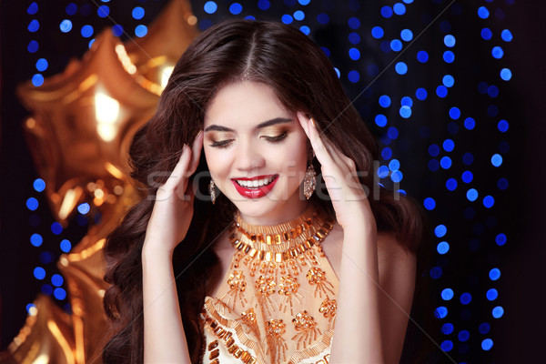 gorgeous, happy smiling young woman with red lips, in luxury gol Stock photo © Victoria_Andreas