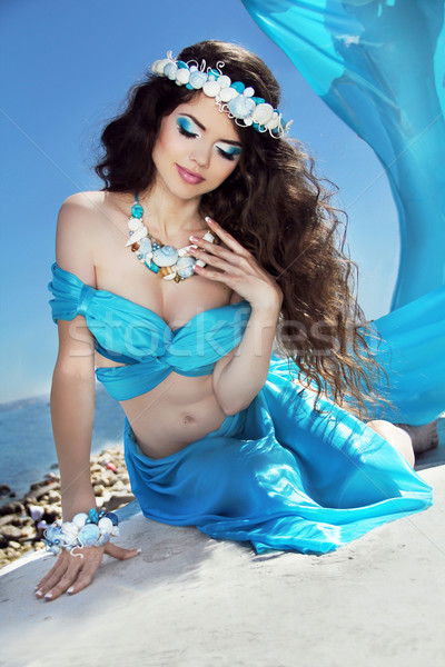 Long Healthy Hair. Beautiful brunette woman in blue silk luxury  Stock photo © Victoria_Andreas