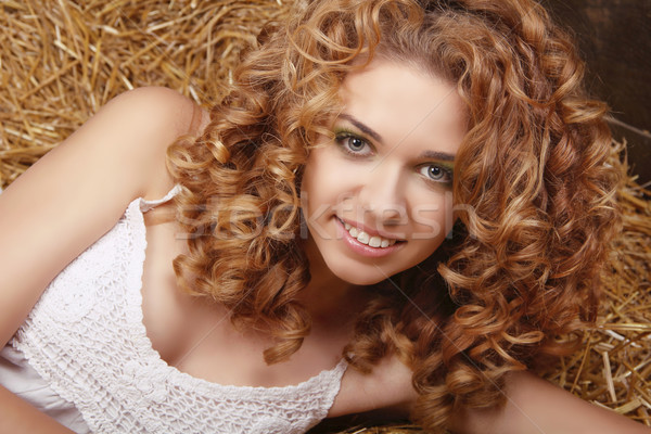 Happy smiling woman portrait with healthy curly hairs on natural Stock photo © Victoria_Andreas