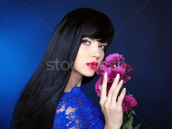 Makeup. Hair. Beautiful girl in blue dress with flowers in hand  Stock photo © Victoria_Andreas