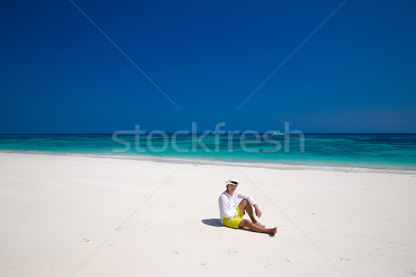 Summer beach. Relax. Successful handsome man in hat resting on e Stock photo © Victoria_Andreas