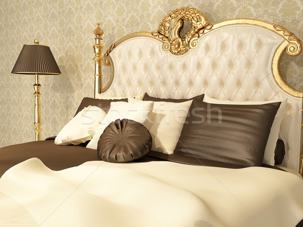 Luxurious bed with pillows and standing lamp in royal interior Stock photo © Victoria_Andreas