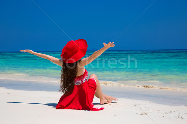 Beautiful woman in hat enjoying and relaxing on beach with white Stock photo © Victoria_Andreas