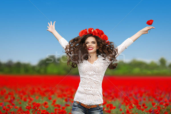 Carefree laughing brunette woman with open arms jumping up over  Stock photo © Victoria_Andreas