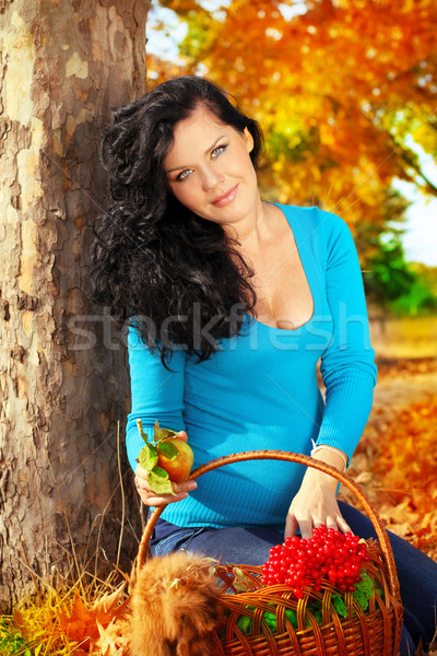 Beautiful pregnant woman with foodstuffs, autumn outdoors Stock photo © Victoria_Andreas