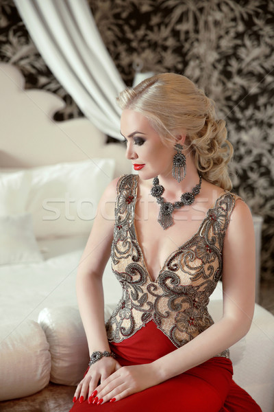 Indoor beauty portrait of blond woman in fashion jewelry and lux Stock photo © Victoria_Andreas
