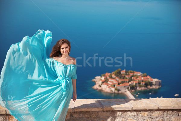 Beauty smiling brunette Girl in blowing dress Outdoors. Happy Yo Stock photo © Victoria_Andreas