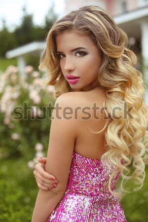 Beauty blond model girl in fashion pink dress with makeup and lo Stock photo © Victoria_Andreas