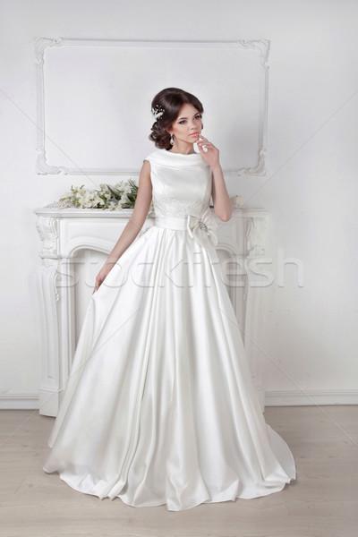 Gyönyörű menyasszony nő pózol fenséges ruha Stock fotó © Victoria_Andreas