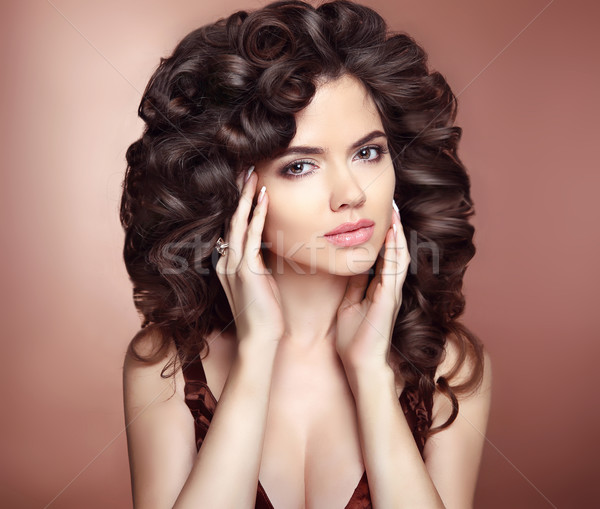 Curly hairstyle. Beautiful girl with long wavy hair. Brunette he Stock photo © Victoria_Andreas