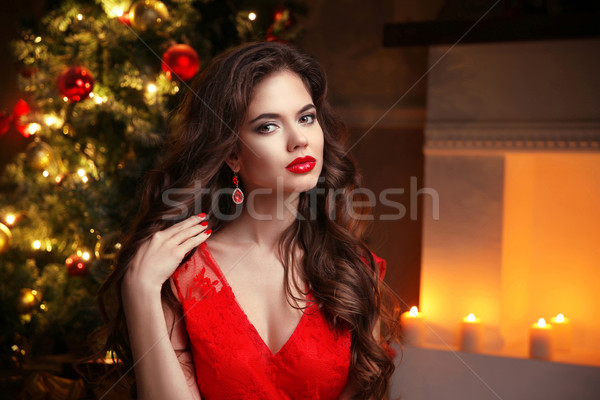 Christmas. Beautiful smiling woman. Fashion ruby earrings jewelr Stock photo © Victoria_Andreas