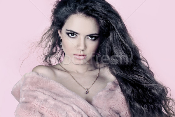 Stock photo: Portrait of a beautiful woman in pink fur coat