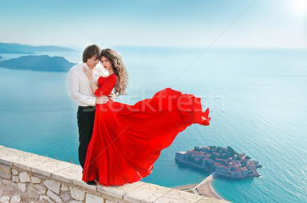 Romantic young couple in love over sea shore background. Fashion Stock photo © Victoria_Andreas