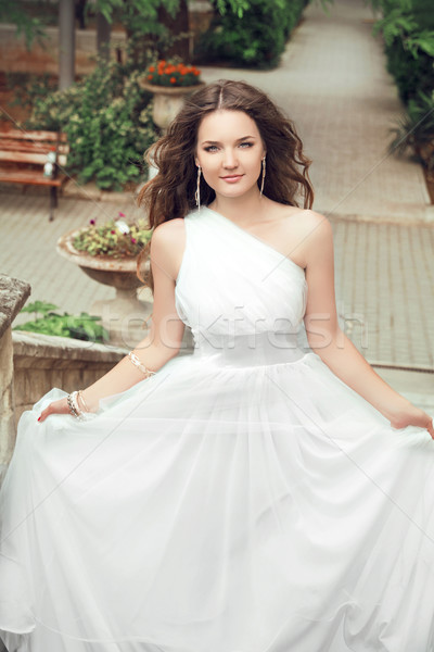 Outdoor Portrait Of Beautiful young bride with long wavy hair in Stock photo © Victoria_Andreas