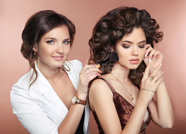 Stock photo: Beautiful women. Haistyle. Makeup Artist holding brush posing wi