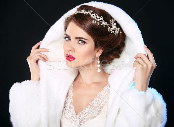 Beautiful woman in white fur coat. Fashion model portrait. Jewel Stock photo © Victoria_Andreas