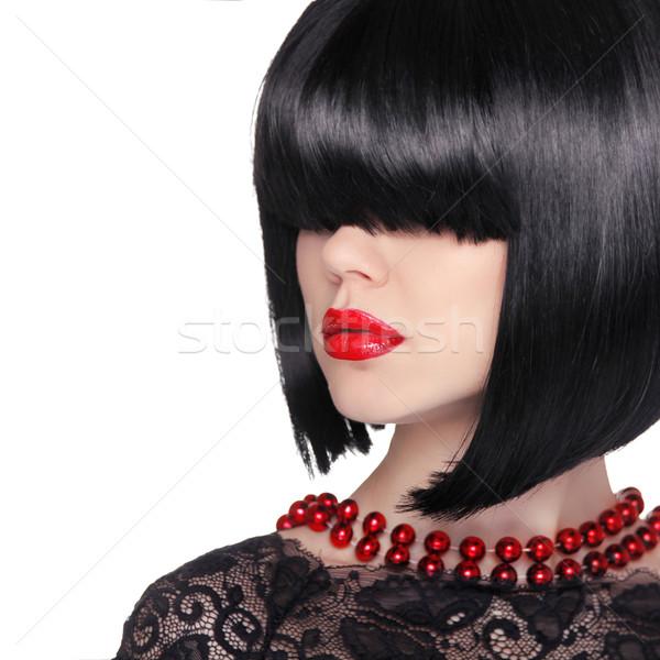 Fashion portrait. Brunette woman. Black short hair style. Red li Stock photo © Victoria_Andreas