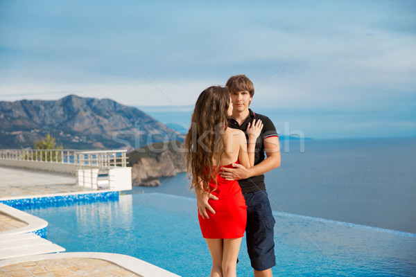 Young fashionable couple against the infinity smimming pool over Stock photo © Victoria_Andreas