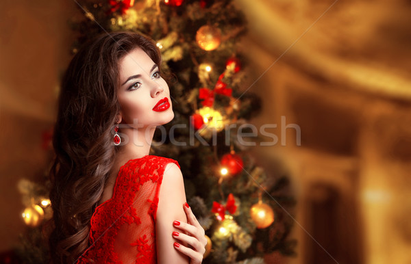 Christmas. Beautiful smiling woman. Manicure nails. Makeup. Heal Stock photo © Victoria_Andreas