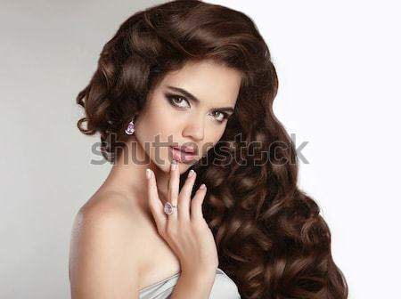 Manicured nails. Hair. Beautiful Brunette Girl Model  with shiny Stock photo © Victoria_Andreas